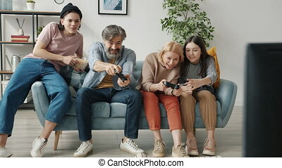 Happy family playing videogame enjoying leisure time together bonding with children