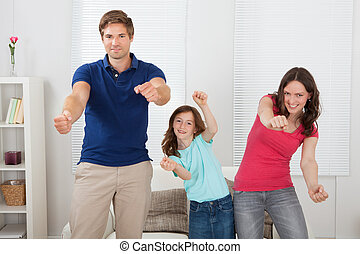 Happy Family Playing Videogame