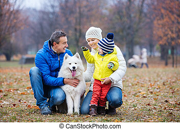 Happy family playing with a dog