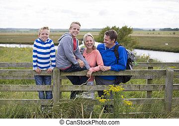 Happy Family Portrait - Happy Family of four on a bridge...