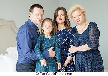 Happy family portrait. Mother, daughter, father and grandmother at home