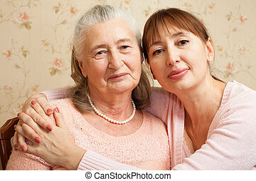 Senior woman with their caregiver at home. - Happy family. ...