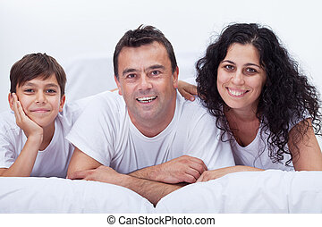 Happy family portrait - boy together with his parents