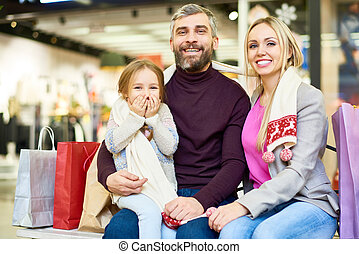 Happy Family  Posing in Shopping Mall