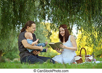 Happy family reading a book