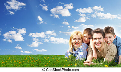Happy family relaxing at the park. Summer vacation.