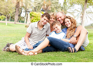 Happy family relaxing in the park