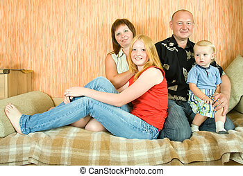 happy family relaxing  on sofa