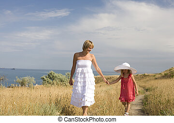 Happy family resting at beach in summer mother with daughter