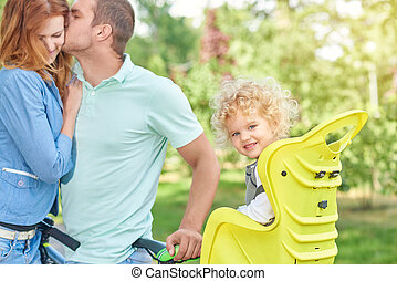 Happy family riding bike at the park