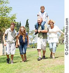 happy family running towards camera - portrait of playfull...