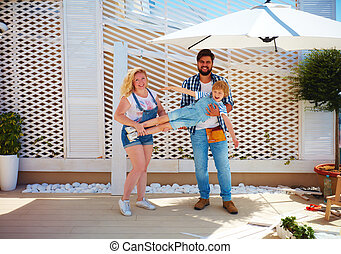 happy family setting up a trellis for plants on patio