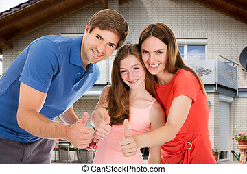 Happy Family Showing Thumb Up Sign