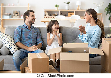 Happy family sitting on couch at new home