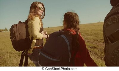 happy family slow motion video walking on nature boy girl and mom in a field on trekking trip. tourists with backpacks traveling lifestyle. happy family travel tourism concept