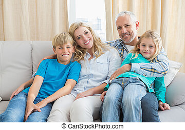 Happy family smiling at camera