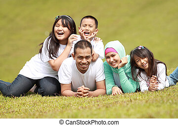 happy family smiling in the park