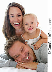 Happy family smiling together - Close up portrait of a happy...