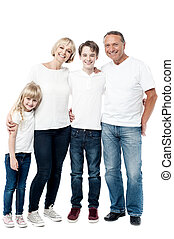Happy family smiling together - Affectionate family of four...