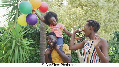 Happy family spending time together - Side view of an ...