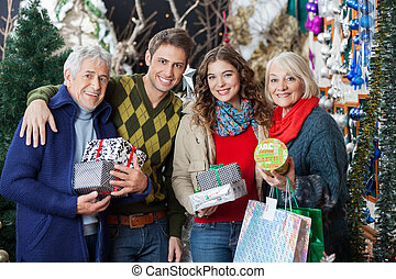 Happy Family Standing Together In Christmas Store