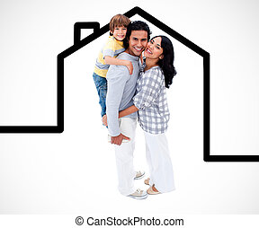 Happy family standing with a house