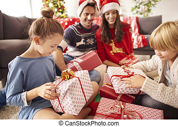 Happy family start opening Christmas presents