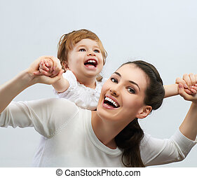 happy family - happy mother holding her baby