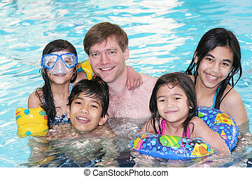 Happy family swimming - Father and his four children...