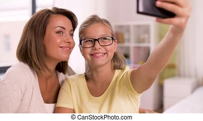 happy family taking selfie by smartphone at home - family,...