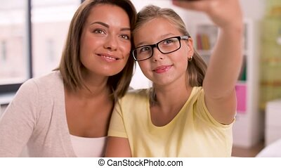 happy family taking selfie by smartphone at home