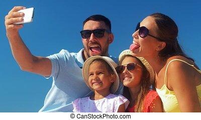 happy family taking selfie on summer beach - family, leisure...