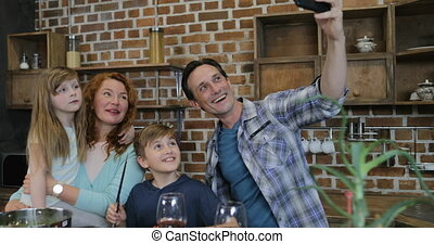 Happy Family Taking Selfie Photo While Cooking In Kitchen...