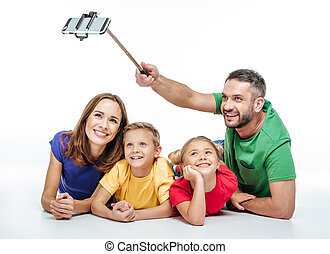 Happy family taking selfie