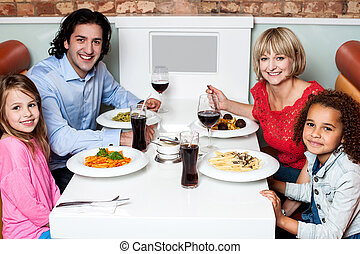 Happy family together in a restaurant