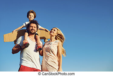 Happy family together in nature.