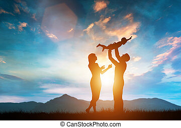 Happy family together outside at sunset