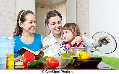 Happy family together  with vegetables in  kitchen