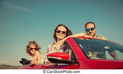 Happy family travel by car in the mountains. People having...