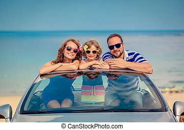 Happy family travel by car to the sea. People having fun in...