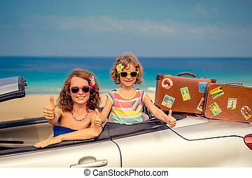 Happy family travel by car to the sea. Woman and child...