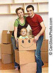 Happy family unpacking in a new home