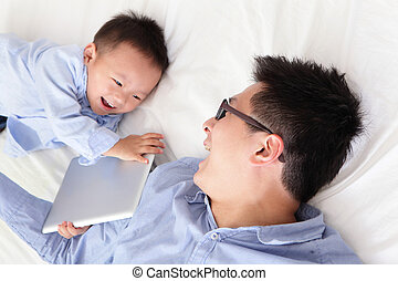 happy family using tablet pc