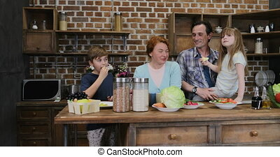 Happy Family Waiting For Preparing Food In Kitchen Cheerful...