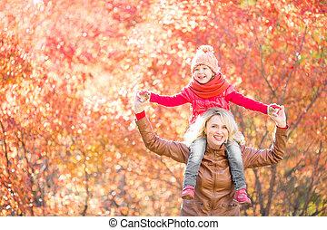Happy family walking in fall