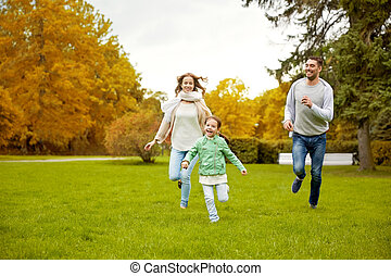 happy family walking in summer park - family, parenthood,...