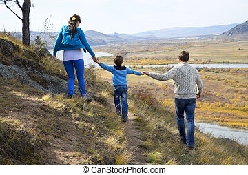 happy family walking in the mountains