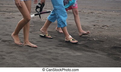 Happy family walking on the beach