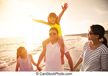 happy family walking on the beach