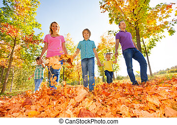 Happy family walking together holding hands